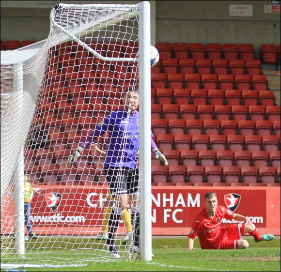 Chorley goalkeeper Sam Ashton can only watch as Harry Williams' header goes in off of the post