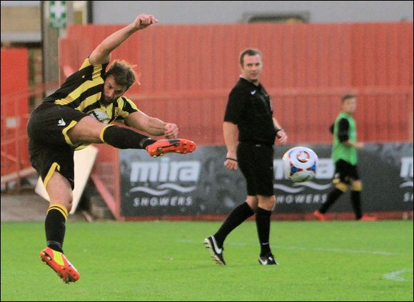 Adam Connolly tries an acrobatic shot against Alfreton