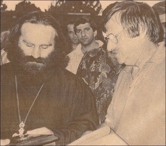 John Beacham swaps gifts with the local religious leader in Achaltsiche
