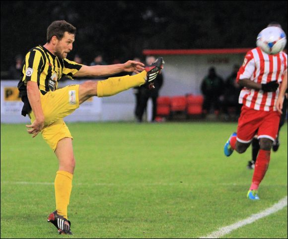 Chris Knowles clears his lines at Brackley