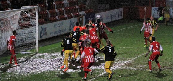Chris Knowles rises highest from a pack of players to equalise for City today