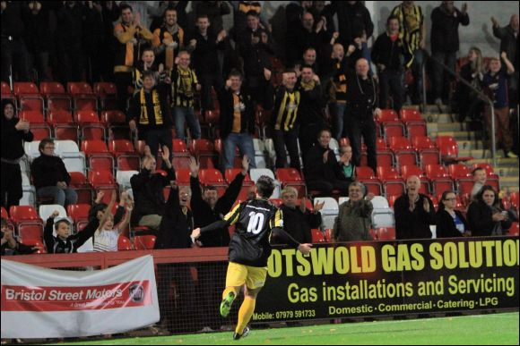 Adam Mann celebrates in front of the City faithful after equalising against Solihuill Moors